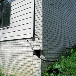 A damaged foundation with wall cracking in Carlin